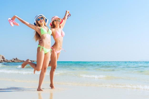 alegria-vacaciones-arena-bikini-sol_1253-833
